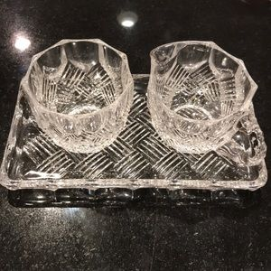 Sugar and creamer  set on glass tray.